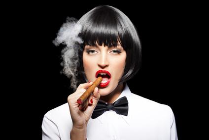 Sexy mafiosi woman smoke with cigar
